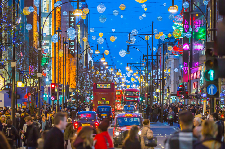 Busy street in London UK to show christmas shoppers and how businesses can deal with seasonal work cover.